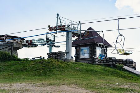 Lift mechanism on top of the hill. Carpathian mountains. Summer time.