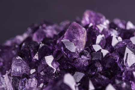 Amethyst geode on black background. Beautiful natural crystals gemstone. Extreme close up macro shot.