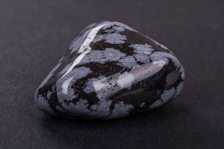 Obsidian geode on black background Stock Photo