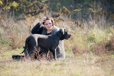 Girl with Italian mastiff puppy Stock Photo
