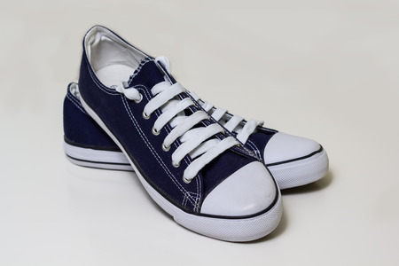 john henry: Blue canvas shoes on white backdrop, brand new Stock Photo