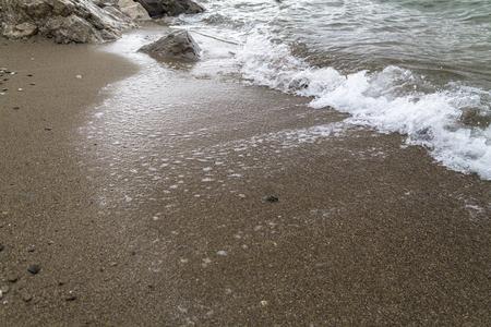 gloom: Gloomy sand beach scene Stock Photo