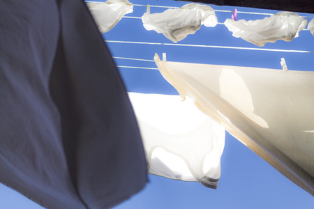 white sheet: Drying laundry on a blue sky Stock Photo