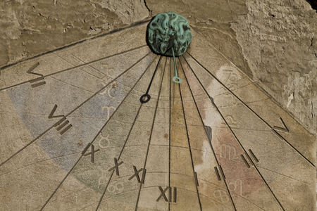 Vintage sun clock on a wall in Zagreb Stock Photo