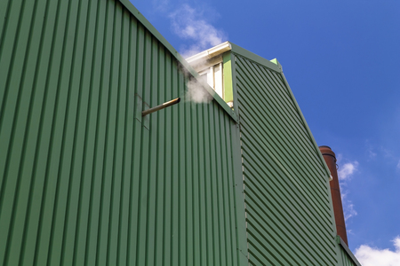 Warehouse exterior on a blue sky Stock Photo
