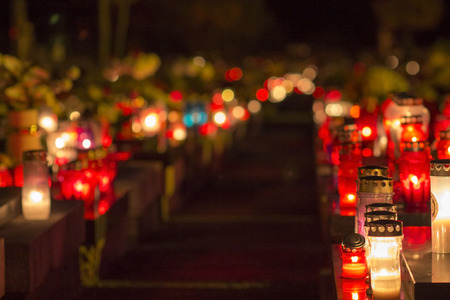 Burning candles on cemetery at night Stock Photo - 90660023