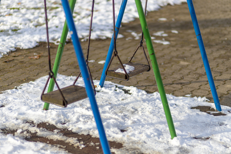 Empty swing in the park in winter Stock Photo - 120219607