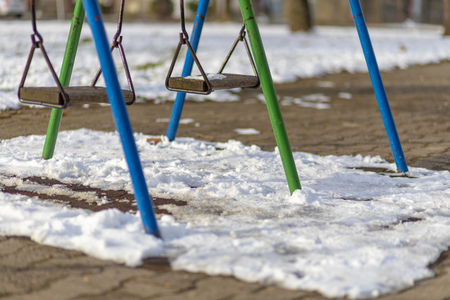 Empty swing in the park in winter Stock Photo