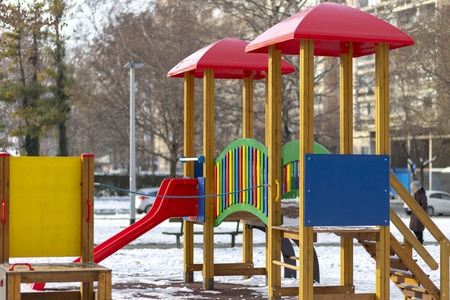 Empty playground in the public park in winter Stock Photo - 120219614