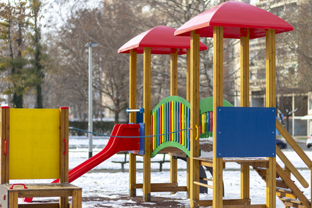 Empty playground in the public park in winter