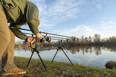 Fisherman doing carp fishing on a sunny morning Stock Photo