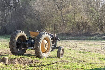 Old tractor in a field in autumn