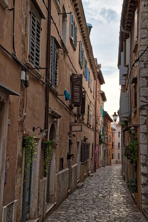 Streets of old town of Rovigno on a gloomy day
