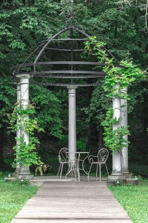 White gazebo for weddings in the woods on a cloudy day Stock Photo - 132049261