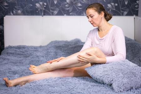 Woman caring for her legs. Reklamní fotografie