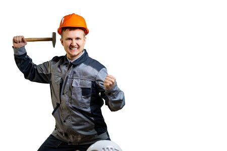 A mad construction worker. An engineer in an orange helmet can no longer restrain his rage. Not paid for the repair, there will be a payment to another. Isolated Reklamní fotografie