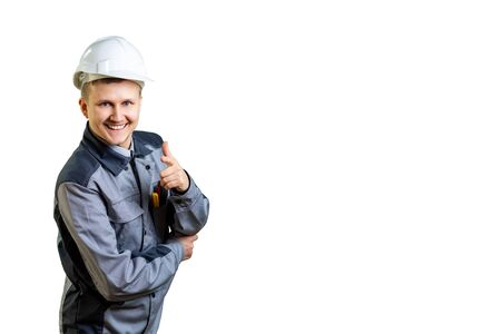 The builder in a white helmet and overalls suggests gestures we have the best of the best repair. Our prices will pleasantly surprise you. isolated Reklamní fotografie