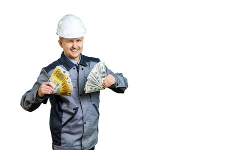 An employee contractor holds money in his hands. He winks at you with his eye and knows how to get rich while working at a construction site. isolated