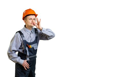 The builder and working engineer shows with a hand gesture that your repair will be done in the best possible way. isolated