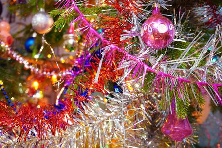 Christmas background with fir branch, New Years toys and tinsel. Photo 스톡 콘텐츠
