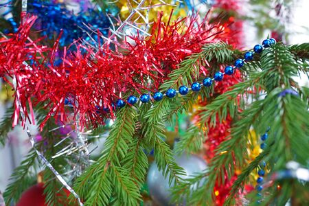Christmas background with fir branch, New Years toys and tinsel. Photo Stockfoto