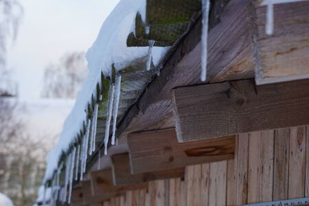Icicles on the wood roof. Photo Stockfoto