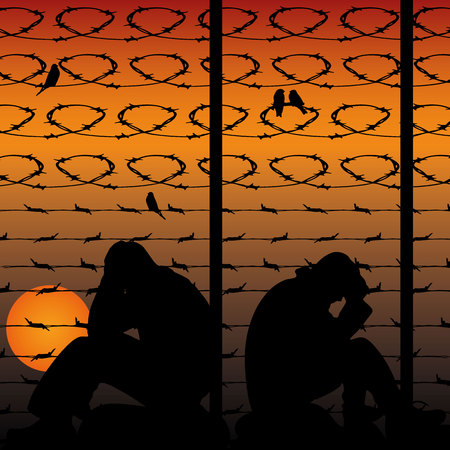 Migrant refugees behind barbed wire, silhouette of two sad men sitting on the ground, against the background of an orange sunset, Stock fotó