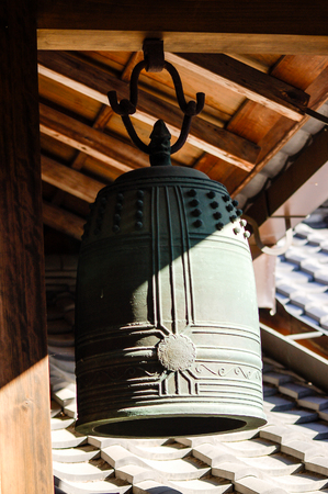 bell bronze bell: The ancient bronze bell of has been lighted by sunlight. Editorial