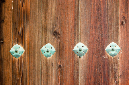 rivets: The old wooden wall is  perforated design with bronze rivets Stock Photo