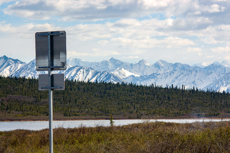 alaska scenic: Back of  Alaska road sign stands with the view on scenic route of Glenn highway. Stock Photo
