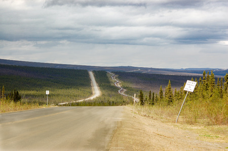 The Dalton highway, which directly parallels the Alaska pipeline, is one of the most isolated roads in the USA. Stock Photo
