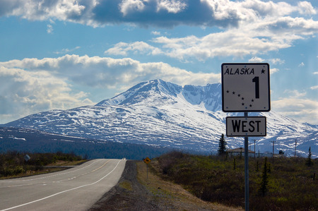 alaska scenic: The Alaska road sign number one shows direction to the west on scenic route of Glenn highway.