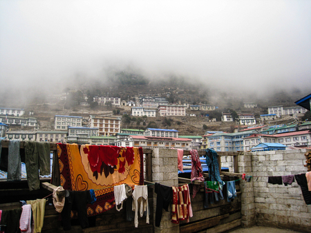 terracing: Clothing was dry in the air on a foggy day at Namche Bazaar in everest region. Stock Photo