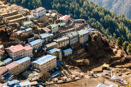 terracing: The buildings of Namche Bazaar village in everest region are on a hillside terracing.