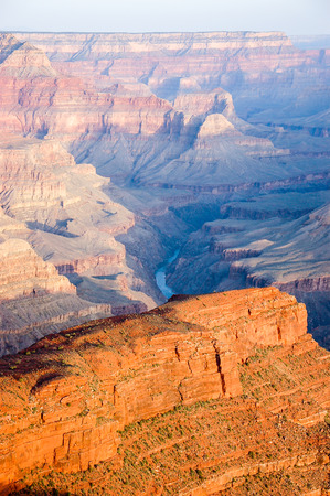 hopi: Grand Canyon skyline scenery with Colorado river at Hopi Point in  vertical view shown morning sunlight and shadow on rocky cliff.