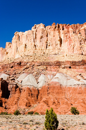 scenic drive: The red rock formation scenery of the scenic drive at Capitol Reef National Park in Utah with bright blue sky on sunshine day in vertical view.