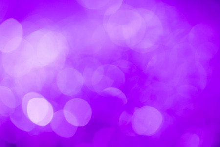 frigid: Purple festive New YearÕs background. Abstract with bright twinkles, sparkles, blurred, defocused light.