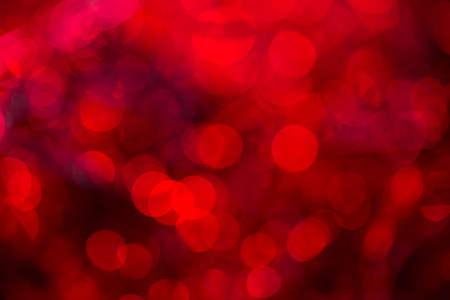extravagant: Red extravagant background. Abstract with bright twinkles, sparkles, blurred, defocused light. Stock Photo