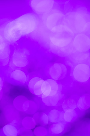 extravagant: Purple extravagant background. Abstract with bright twinkles, sparkles, blurred, defocused light. Stock Photo