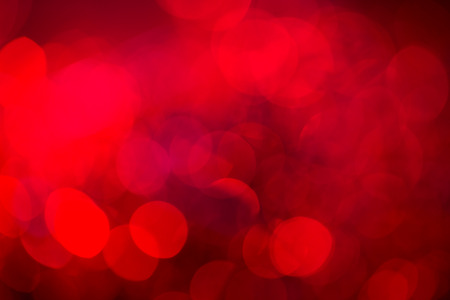 Red festive New Year�s background. Abstract with bright twinkles, sparkles, blurred, defocused light. photo