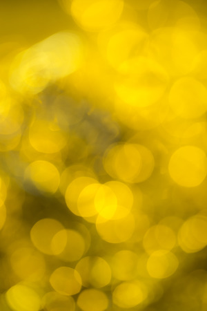 extravagant: Golden extravagant background. Abstract with bright twinkles, sparkles, blurred, defocused light.