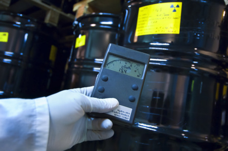 hazardous: Man checking radiation with geiger counter Stock Photo