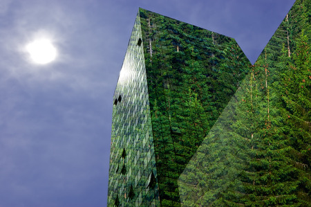 eco building: Green energy in the city: modern building covered with spruce forest