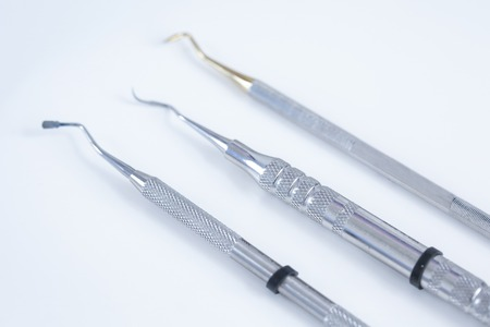 Dental instruments - plugger, burnisher and probe Stock Photo