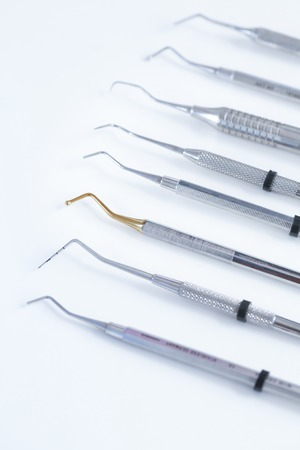 dental hygienist: Various dental instruments - burs, pluggers, burnishers, periodontal scalers and probes Stock Photo