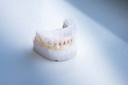 computerized: Invisalign, invisible plastic teeth aligner on a dental plaster mold Stock Photo