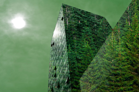 Green energy in the city: modern building covered with spruce forest photo
