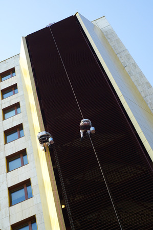 heights: Two men cleaning a facade