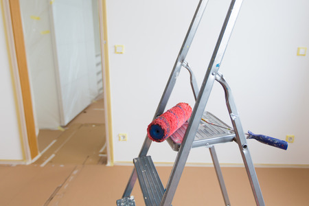 Ladder and red roller, home renovation photo