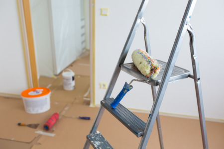 Ladder, roller and buckets, home renovation photo